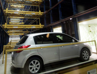 Robotic Parking Systems cars are delivered for easy exit.