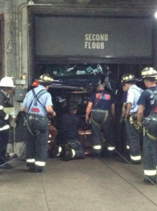 Car and driver plunges down an elevator shaft.